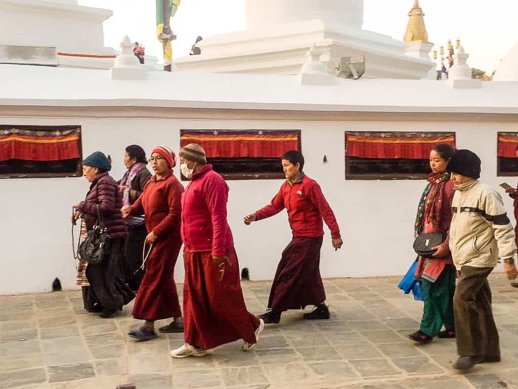 Worshipers walking around Boudha Stupa