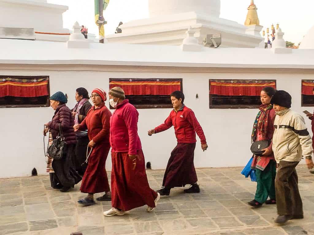 Worshipers walking around Boudha Stupa