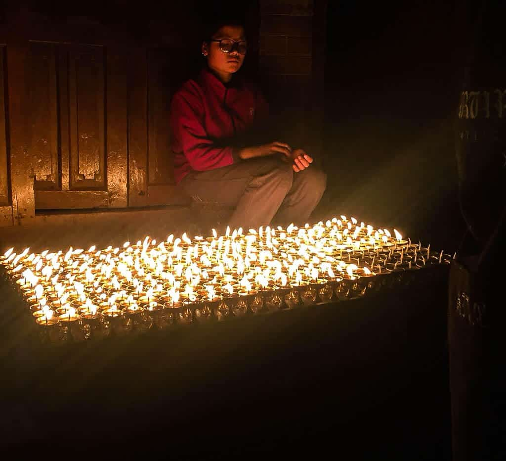 A butter lamp seller at Boudha Stupa